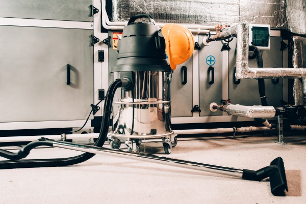 An industrial vacuum in an industrial facility